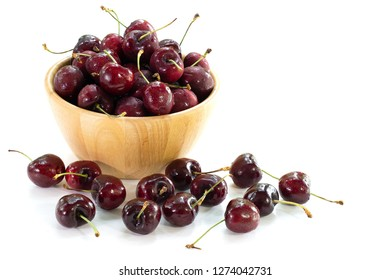 Fresh cherries in the wooden chalice on white background / Select focus, space for texts