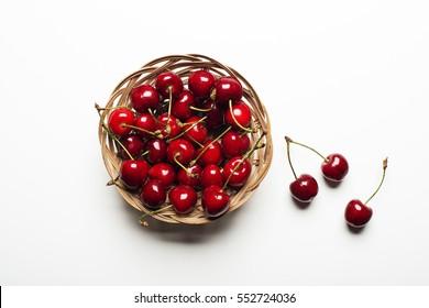 Fresh Cherry basket on white background close up