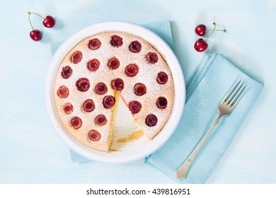 fresh cherry cake on a blue table