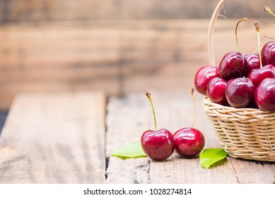 Fresh Cherry from farm, sweet and sour fruit, wooden table background and copy space for text