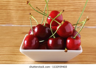 fresh cherry fruit in wooden background