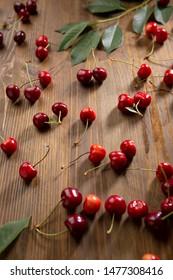 Fresh cherry on  wooden background, summer concept