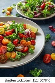 Fresh Cherry Tomato mix salad with lettuce, lemon, lime, black pepper and sea salt. healthy food