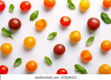 Fresh cherry tomato pattern. Various colorful tomatoes on a white background. Repetition concept. Top view