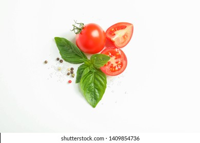 Fresh cherry tomatoes with basil and spices on white background, space for text and top view. Ripe vegetables