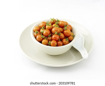 Fresh cherry tomatoes in bowl isolated on white background