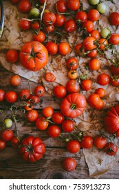 Fresh cherry tomatoes on rustic wooden table, Top view with copy space.