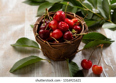 Fresh cherry in wooden basket