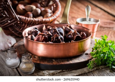Fresh chestnuts  with garlic sauce