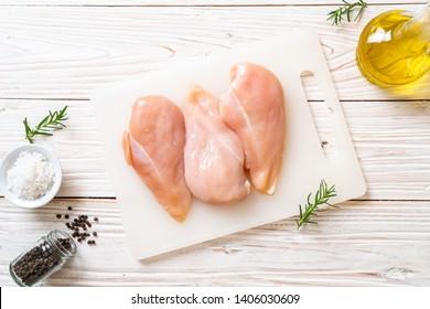 fresh chicken breast raw on cutting board