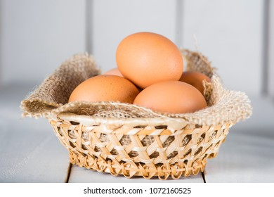Fresh chicken eggs in a basket on the kitchen table