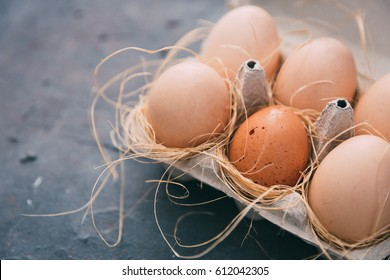 Fresh chicken eggs in tray over vintage background