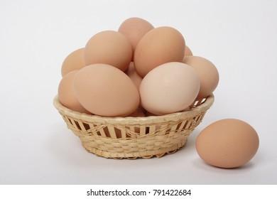 Fresh chicken eggs in a wicker plate
