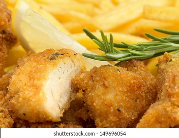fresh chicken nugget with rosemary, lemon and fries
