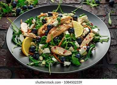 Fresh Chicken salad with Blueberries, feta, carrots, nuts and green vegetables. healthy food concept