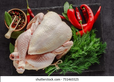 Fresh chicken with spices on vintage background with copyspace, selective focus. Healthy food, diet or cooking concept