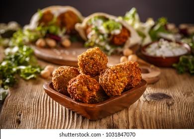 Fresh chickpeas falafel in wooden bowl
