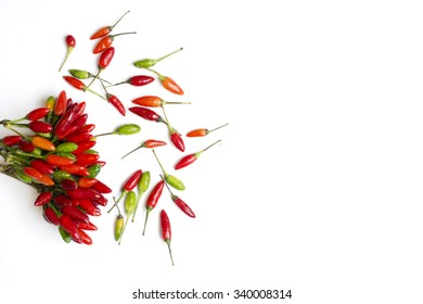 fresh chilli peppers, various kinds on white, space for advertising text, selective focus