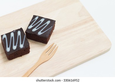 Fresh chocolate brownies on wood plate and ready for serving