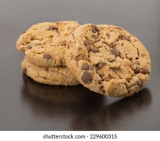 Fresh chocolate cookies isolated on black background