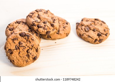 Fresh, chocolate cookies on wooden table