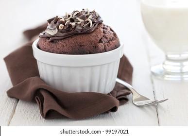 fresh chocolate muffin in a ramekin with fork
