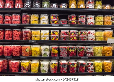 Fresh chopped and chunks fruit plastic box display in store at Houston, Texas, US. In-house cut, packed watermelon, mango, cantaloupe, mixed berry, coconut to take away. Convenience, healthy lifestyle
