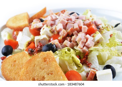 fresh chopped ham salad with cheese on  white plate