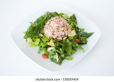 fresh chopped tuna salad on a white plate
