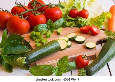Fresh chopped vegetables on cutting board