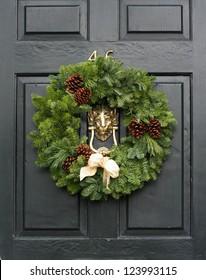 Fresh Christmas wreath on a door