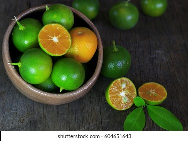 Fresh Citrus calamondin fruit on Wooden Background
