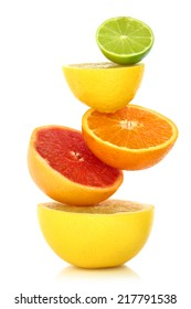 Fresh citrus fruit in a row on white background. Vitamin c concept