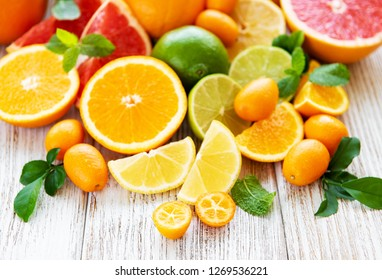 Fresh citrus fruits on a old wooden background
