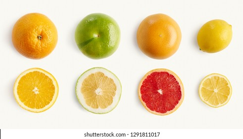 Fresh citrus fruits orange, lemon, grapefruit, pomelo whole half-sliced from above, pattern for layout. concept of healthy eat food and nutrition, space for layout.