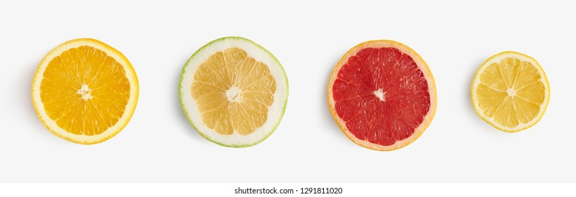 Fresh citrus fruits orange, lemon, grapefruit, pomelo half-sliced from above, pattern for layout.  healthy food and nutrition.
