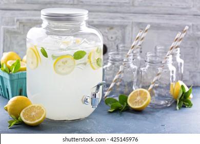 Fresh citrus lemonade with lemons in beverage dispenser