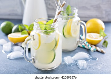 Fresh citrus lemonade with limes and lemons in mason jars