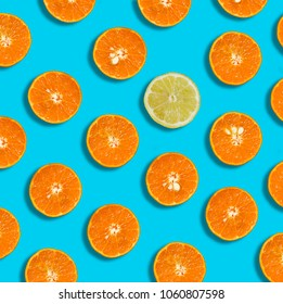 fresh citrus slices on bright blue background. Healthy lifestyle and different concept