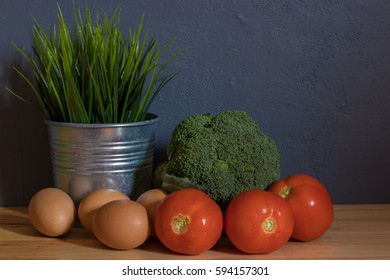 fresh clean vegetable with egg on wooden table background,Image for healthy and diet food concept.