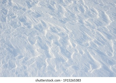 Fresh clean white snow background texture. Winter background with snowflakes and snow mounds. Snow lumps. Seasonal landscape details.