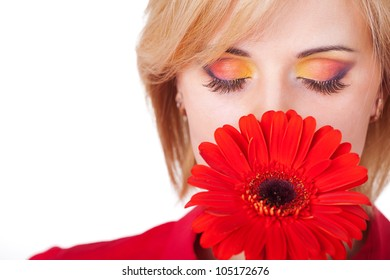 Fresh clear healthy skin on the face of beautiful woman with flower. studio portrait