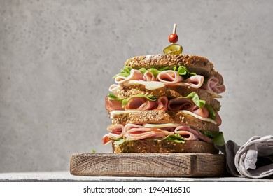 Fresh club sandwich with ham and cheese