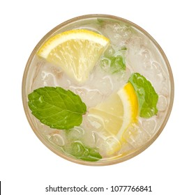 Fresh cocktail lemonade, honey lemon soda with yellow lime slice and mint top view isolated on white background, clipping path include