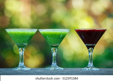 fresh cocktail in martini glass on wooden board. bokeh background.