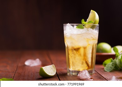 Fresh cocktail prepared with ginger beer, lime and ice. Beverage on the table
