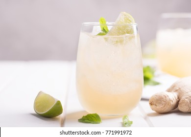 Fresh cocktail prepared with ginger beer, lime and ice. Beverage on the table. Image contains copy space for text