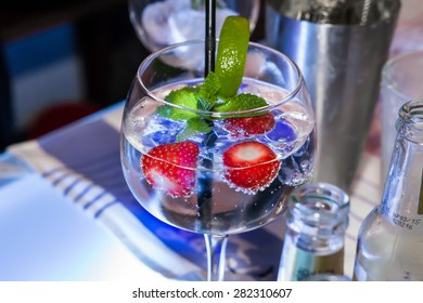 Fresh cocktail with strawberries at nightclub close-up