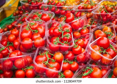 Fresh cocktail tomatoes on display at Broadway Market, a street market in Hackney, East London