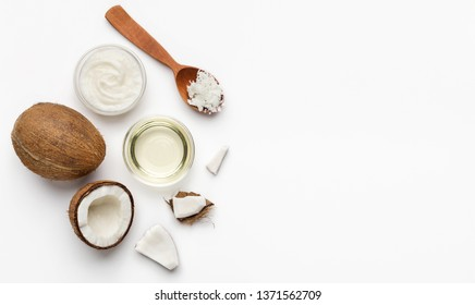 Fresh coconut and coco oil on white background top view, copy space. Vegetable fats concept